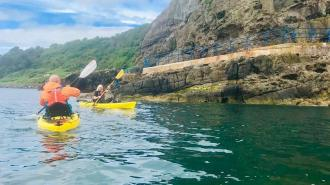 Kayak in Whitehead and see Blackhead Path